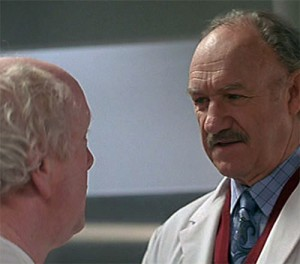 Dr. Myrick (Gene Hackman) speaks with a homeless research patient who thinks he's at the hospital for minor routine treatment. (from Extreme Measures)